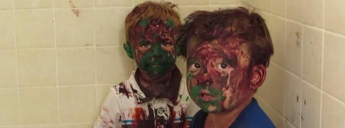 Video: Two paint-covered boys try to act natural as dad quizzes them on their actions!