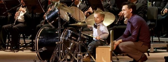 3-year-old little drummer boy plays with full orchestra