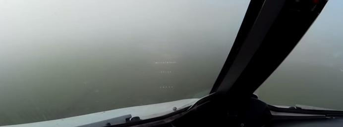 Watch: Pilot's perspective of landing in thick fog at...