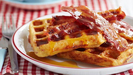 Potato and cheese waffles with crispy bacon and spiced maple syrup