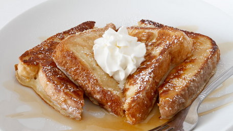 French toast with sticky toffee walnut sauce, served with whipped vanilla cream